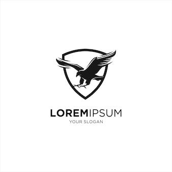Logotipo de silhueta de escudo de segurança falcão