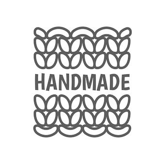Logotipo de tricô feito à mão em emblema de tricô feito à mão
