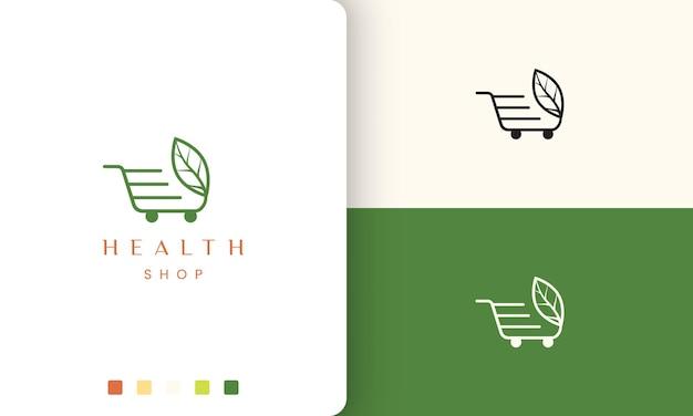 Logotipo do carrinho para loja de produtos naturais ou saudáveis em estilo simples e moderno