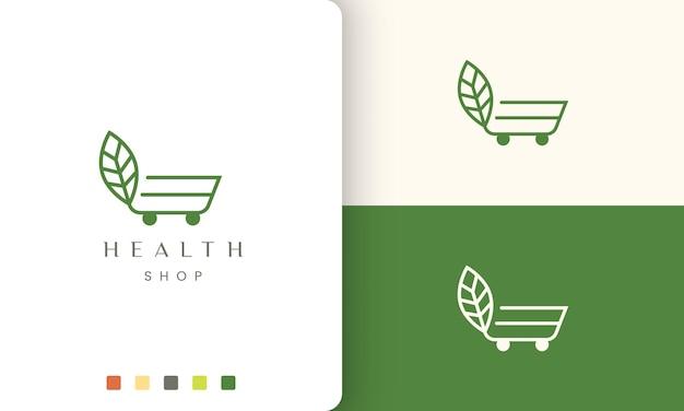 Logotipo do carrinho para loja natural ou orgânica em estilo simples e moderno