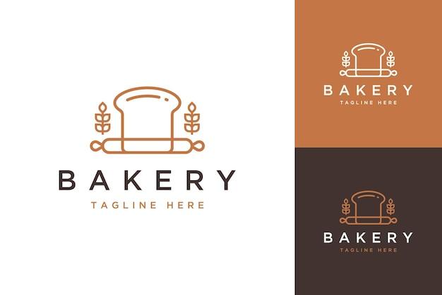 Logotipo do design da padaria ou pão com moedor e trigo