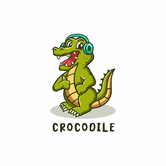 Logotipo do mascote dos desenhos animados do crocodilo crocodilo com fone de ouvido