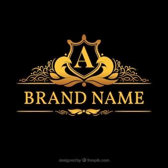 "Logotipo do monograma com letra dourada ""a"""