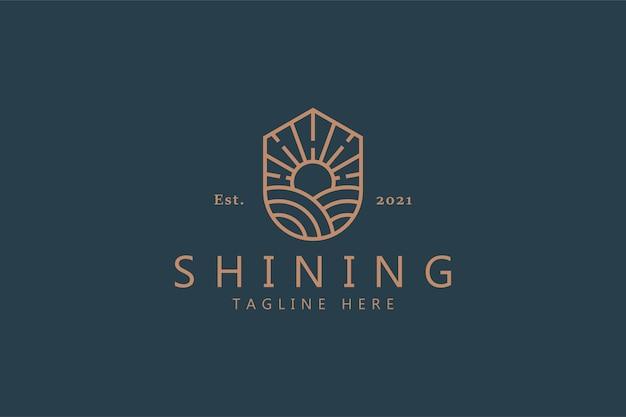Logotipo do nascer do sol no escudo para produtos da farm business company. brilhando brilhante conceito vetor modelo de identidade de marca.