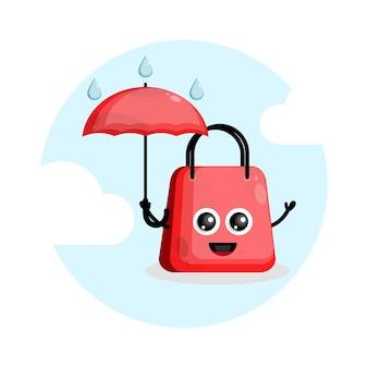 Logotipo do personagem do mascote do saco de compras com guarda-chuva de chuva Vetor Premium