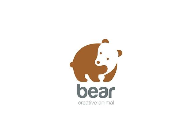 Logotipo engraçado do urso. estilo de espaço negativo.