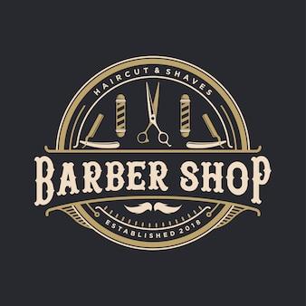Logotipo vintage de loja de barbeiro