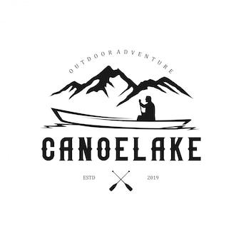 Logotipos ao ar livre com elementos de montanha e canoas