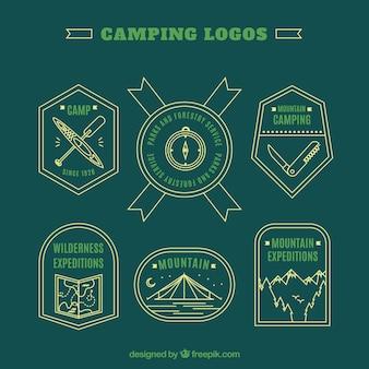 Logotipos de aventura verde desenhados mão