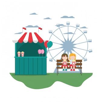 Loja de carnaval com crianças sentadas com pipoca