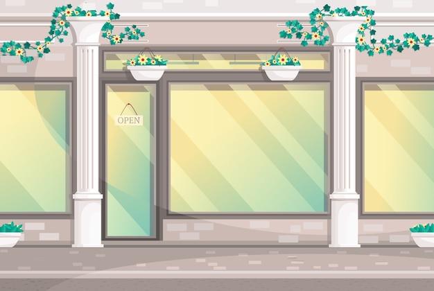 Loja elegante com colunas e com placa de identificação aberta nas portas