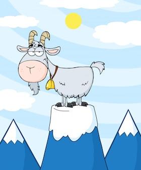 Longhorn de cabra no topo de um pico de montanha