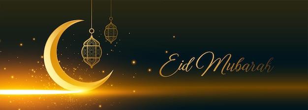 Lua dourada brilhante eid mubarak e banner com lanterna