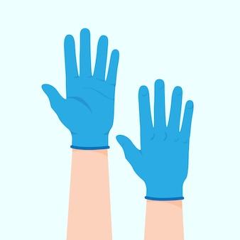 Luvas azuis de proteção nas mãos