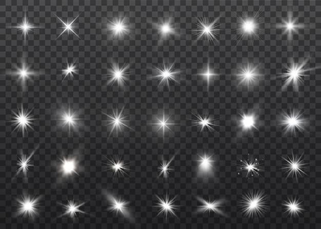 Luz branca brilhante explode em um fundo transparente. partículas de poeira mágica cintilante. estrela brilhante.