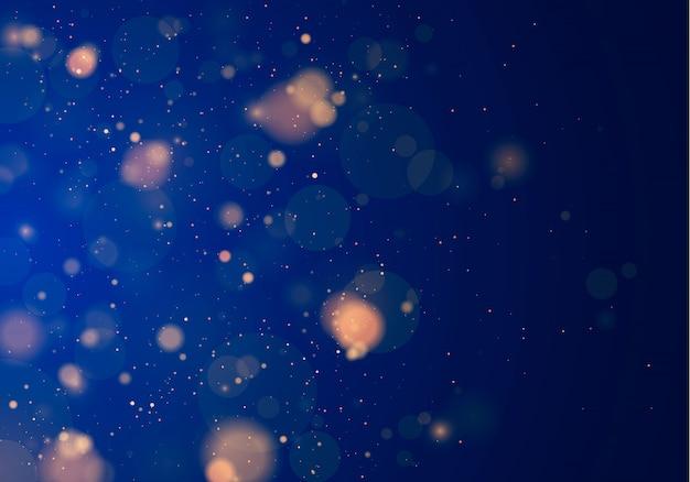 Luz desfocada bokeh em fundo azul escuro. e modelo de feriados de ano novo. brilho abstrato desfocado estrelas piscando e faíscas.