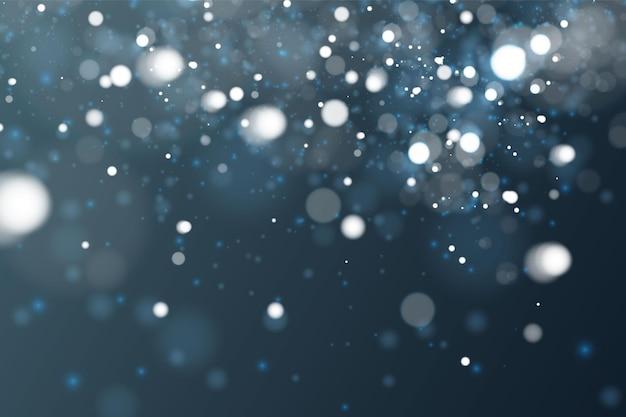 Luz desfocada bokeh em fundo azul escuro. modelo de feriados de natal e ano novo. brilho abstrato desfocado estrelas piscando e faíscas.