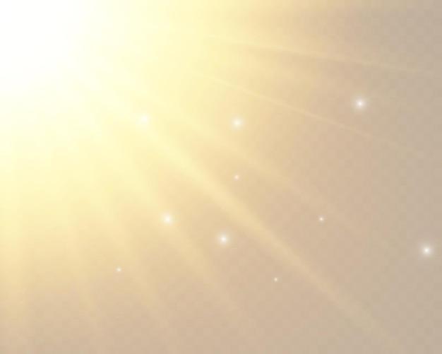 Luz do sol em um fundo transparente. efeitos de luz brilhante. brilho do sol em fundo transparente.