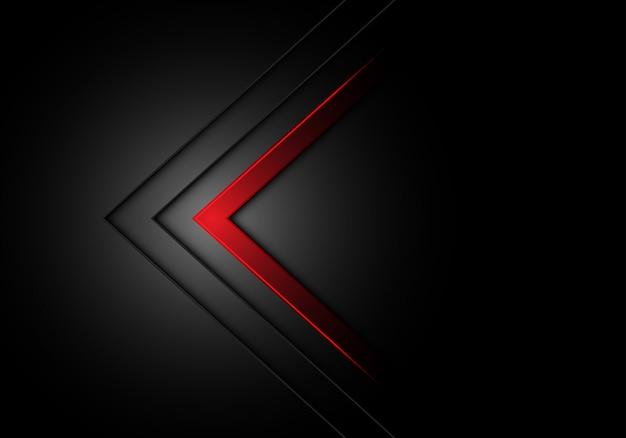 Luz fraca do sentido vermelho da seta no fundo preto.