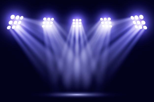 Luzes azuis brilhantes do refletor no estádio