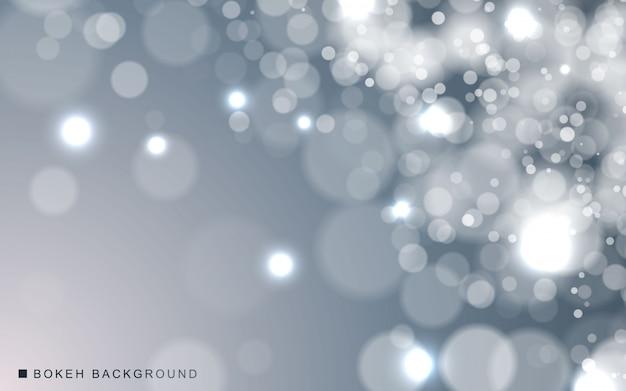Luzes brilhantes cintilantes de fundo prata bokeh