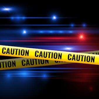 Luzes da polícia e fitas de advertência