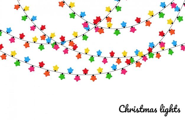 Luzes de natal. lâmpadas decorativas coloridas para decoração em uma festa de natal.