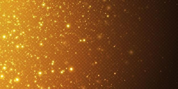 Luzes douradas caindo do natal. pó de ouro abstrato mágico e brilho. fundo festivo de natal. partículas de ouro abstratas e glitter em um fundo preto.