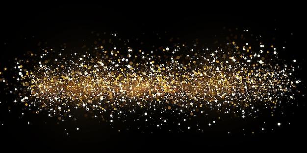 Luzes douradas caindo do natal. pó de ouro abstrato mágico e brilho.