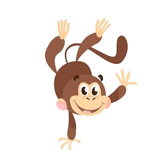 Macaco alegre dos desenhos animados, fazendo parada de mãos