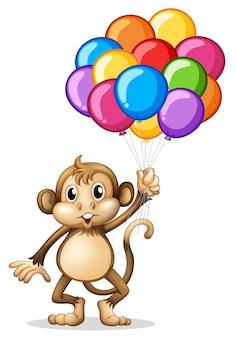 Macaco bonito com balões coloridos