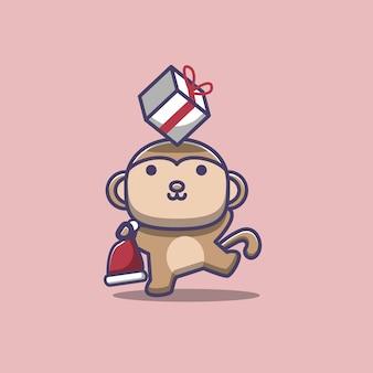 Macaco brincando com presentes de natal e chapéu de papai noel