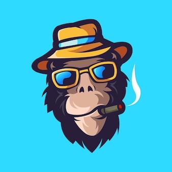 Macaco com mascote de óculos isolado em azul