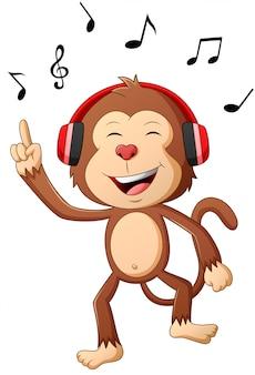 Macaco de desenho animado ouvindo música. ilustração