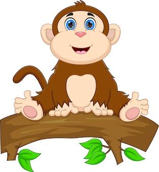 Macaco de desenho animado sentado em uma árvore