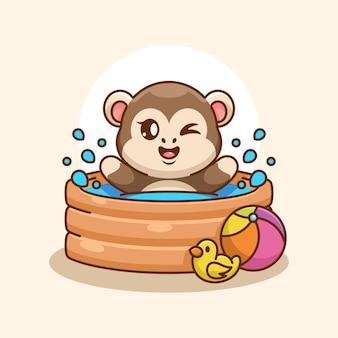 Macaco fofo brincando em uma piscina inflável