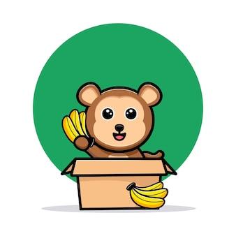 Macaco fofo dentro da caixa e acenando com o mascote dos desenhos animados de banana