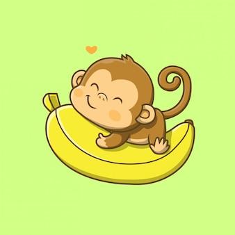 Macaco fofo segurando uma ilustração de banana grande