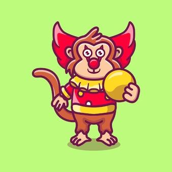 Macaco palhaço fofo do dia das bruxas carregando bola