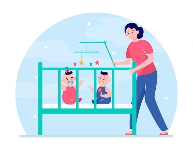 Mãe acalmando bebês gêmeos no berço