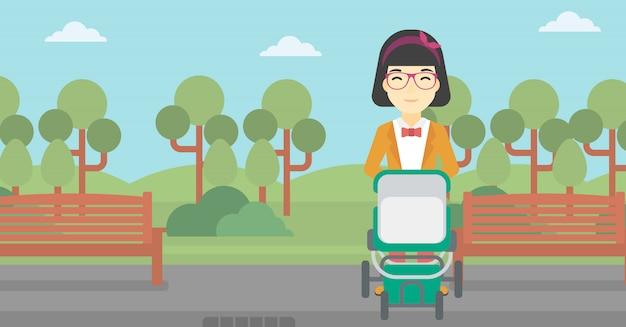 Mãe andando com carrinho de bebê.