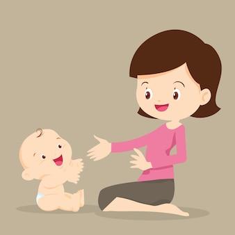Mãe brincando com bebê