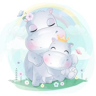 Mãe e bebê pequeno bonito do hipopótamo