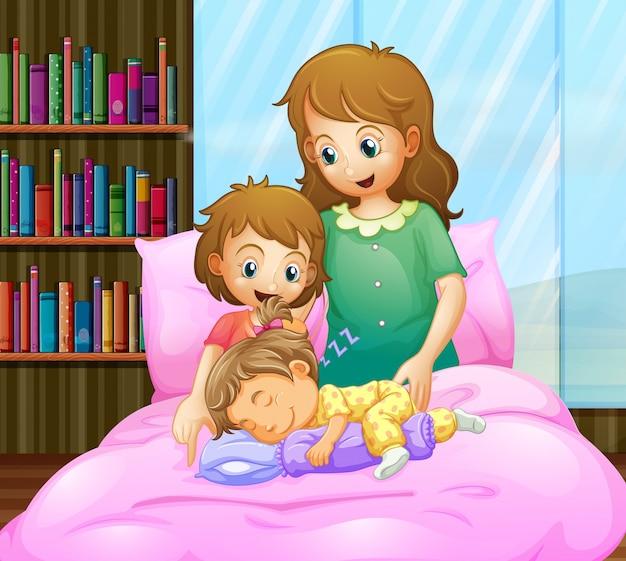Mãe e duas meninas na cama