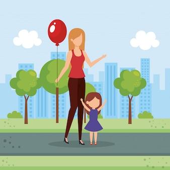 Mãe e filha com balão