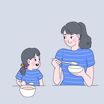 Mãe e filha estão comendo juntas