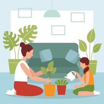 Mãe e filha plantam plantas na sala