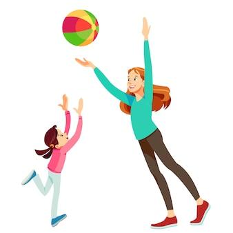 Mãe e filha se divertindo com uma bola Vetor Premium