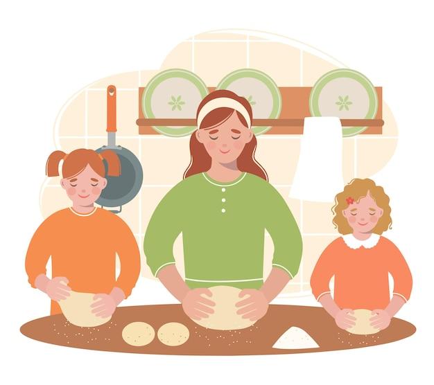 Mãe e filhas na cozinha preparam pãezinhos fofos.