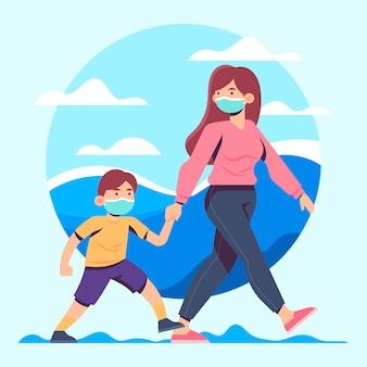 Mãe e filho andando com máscaras médicas